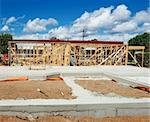 New residential construction home framing against a blue sky Stock Photo - Royalty-Free, Artist: LevKr                         , Code: 400-04841373