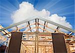 New residential construction home framing against a blue sky. Stock Photo - Royalty-Free, Artist: LevKr                         , Code: 400-04842336
