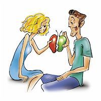 couple in love with two halves of apple Stock Photo - Royalty-Freenull, Code: 400-04844338