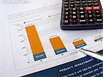 Pen on the project investment chart with calculator Stock Photo - Royalty-Free, Artist: NAN104                        , Code: 400-04850955