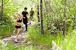 Three friends running in the forest on pathway Stock Photo - Royalty-Free, Artist: Leaf                          , Code: 400-04851590