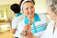 sweaty woman - Portrait of aged women interacting in sport gym Stock Photo - Royalty-Freenull, Code: 400-04852205