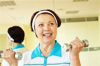 sweaty woman - Portrait of aged woman doing physical exercise with barbells Stock Photo - Royalty-Freenull, Code: 400-04852206