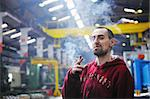 industry worker smoking cigarette Stock Photo - Royalty-Free, Artist: dotshock                      , Code: 400-04853000