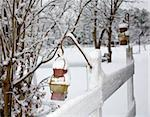 Fencepost with two lanterns hanging during a winter storm Stock Photo - Royalty-Free, Artist: gsagi                         , Code: 400-04853131