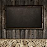 Photo of empty natural wooden interior with blackboard