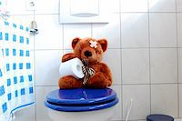 toy teddy bear with paper in the bathroom on toilet Stock Photo - Royalty-Freenull, Code: 400-04860845