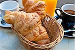 Breakfast with coffee and croissants in a basket on table Stock Photo - Royalty-Free, Artist: ilolab                        , Code: 400-04863637