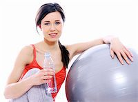 sweaty woman - Young and beautiful girl with bottle of mineral water in gym Stock Photo - Royalty-Freenull, Code: 400-04868261