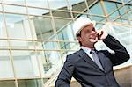 Portrait of confident foreman in helmet calling by mobile phone Stock Photo - Royalty-Free, Artist: pressmaster                   , Code: 400-04870589