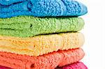 Colorful towels on a white background with space for text Stock Photo - Royalty-Free, Artist: tish1                         , Code: 400-04872988