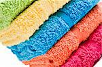 Colorful towels on a white background with space for text Stock Photo - Royalty-Free, Artist: tish1                         , Code: 400-04872989