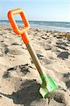beach shovel placed on sand Stock Photo - Royalty-Free, Artist: Studio1One, Code: 400-04874650