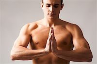 Image of shirtless man keeping his hands put together by chest Stock Photo - Royalty-Freenull, Code: 400-04874847