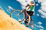 bicyclist  in the desert against blue sky Stock Photo - Royalty-Free, Artist: GekaSkr                       , Code: 400-04876923