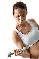 sweaty woman - Image of fit woman doing exercise with barbell in hand Stock Photo - Royalty-Freenull, Code: 400-04879595