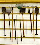 Garden tools on the white wooden wall Stock Photo - Royalty-Free, Artist: JelenaKa                      , Code: 400-04883240