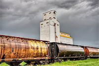 Prairie Grain Elevator in Saskatchewan Canada with storm clouds Stock Photo - Royalty-Freenull, Code: 400-04883751