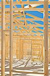 New residential construction home framing against a blue sky. Stock Photo - Royalty-Free, Artist: LevKr                         , Code: 400-04886131