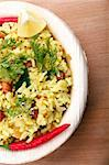 Indian rice breakfast - yellow rice garnished with coriander Stock Photo - Royalty-Free, Artist: smarnad                       , Code: 400-04886623