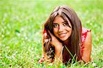 Beautiful woman lying on a grass Stock Photo - Royalty-Free, Artist: logoff                        , Code: 400-04891441
