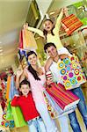 Parents with two children shopping in trade center Stock Photo - Royalty-Free, Artist: pressmaster                   , Code: 400-04892066