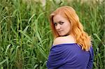 Pretty girl with red haer relaxing outdoor in grass Stock Photo - Royalty-Free, Artist: bezhanoff                     , Code: 400-04892347