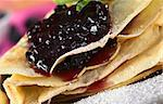 Folded pancake filled with blueberry jam and sugar powder on top (Selective Focus, Focus on the front of the jam filling and the lower pancake rims) Stock Photo - Royalty-Free, Artist: ildi                          , Code: 400-04894615