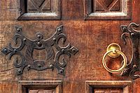 Fragment of vintage wooden door with ornament and round golden doorhandle. Stock Photo - Royalty-Free, Artist: rglinsky, Code: 400-04895963