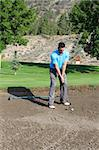 Young male golfer hitting a shot from the bunker Stock Photo - Royalty-Free, Artist: vanell                        , Code: 400-04896175