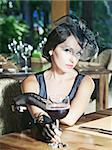 Fashion woman retro portrait in a restaurant Stock Photo - Royalty-Free, Artist: GoodOlga                      , Code: 400-04899033