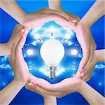 light bulb in women hand making a circle Stock Photo - Royalty-Free, Artist: pariwatlp                     , Code: 400-04899931