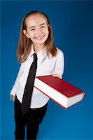 education loan - Little girl giving a book Stock Photo - Royalty-Freenull, Code: 400-04902154