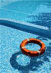 Life saver buoy ring floating in turquoise swimming pool Stock Photo - Royalty-Free, Artist: Anterovium                    , Code: 400-04903194