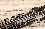 Fragment of black shining clarinet over opened music book Stock Photo - Royalty-Free, Artist: simply                        , Code: 400-04906356