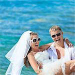 Groom holding up a bride on the beach Stock Photo - Royalty-Free, Artist: GoodOlga                      , Code: 400-04907285