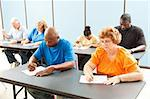 Diverse adult education class taking a test in the classroom. Stock Photo - Royalty-Free, Artist: lisafx                        , Code: 400-04907425