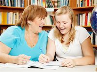 Teen girl in the library studying with her mother (or teacher.) Stock Photo - Royalty-Freenull, Code: 400-04907434