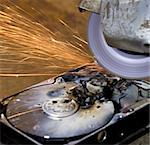 destructed, burned  open hard disk with circular saw Stock Photo - Royalty-Free, Artist: gewoldi                       , Code: 400-04907935