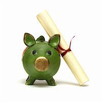 education loan - An isolated shot of a piggy bank and diploma scroll for saving for an education. Stock Photo - Royalty-Freenull, Code: 400-04908013