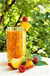 Peach cocktail in the garden in hot summer, sunny day with raspberries Stock Photo - Royalty-Free, Artist: hubavasi                      , Code: 400-04911984