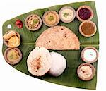 South indian lunch including rice, chapatti and curries on banana leaf with clipping mask Stock Photo - Royalty-Free, Artist: smarnad                       , Code: 400-04913168
