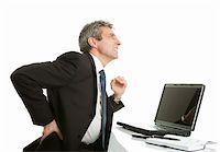 Senior business men having back pain. Isolated on white Stock Photo - Royalty-Freenull, Code: 400-04915389