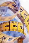 Yellow metric tape measure in closeup.   Stock Photo - Royalty-Free, Artist: stocksnapper                  , Code: 400-04917441