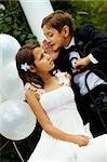 Portrait of boy groom whispering secret to his bride Stock Photo - Royalty-Free, Artist: pressmaster                   , Code: 400-04919891
