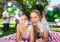 Mother and daughter having fun in the park Stock Photo - Royalty-Freenull, Code: 400-04920719