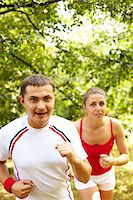 sweaty woman - Image of happy young sportsman running with his girlfriend behind Stock Photo - Royalty-Freenull, Code: 400-04921134
