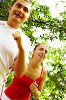 sweaty woman - Image of happy young female running with boyfriend near by Stock Photo - Royalty-Freenull, Code: 400-04921135