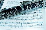 Fragment of black shining clarinet over opened music book Stock Photo - Royalty-Free, Artist: simply                        , Code: 400-04921541
