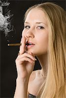 Young cute woman, smoking cigarette Stock Photo - Royalty-Freenull, Code: 400-04921775
